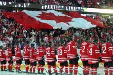 Canadian flag displayed during national anthem of Canada's national sport....hockey.  Image Source