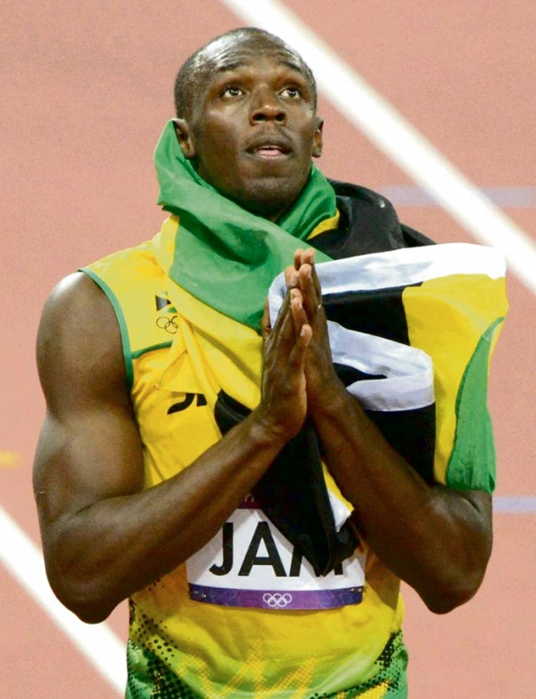 Jamaican Usain Bolt prays after winning the men's 4x100-meter relay final at the Olympic Stadium in London on Aug. 11, 2012. Jamaica team set a new world record of 36.84 seconds. ( The Yomiuri Shimbun via AP Images ).  Image Source