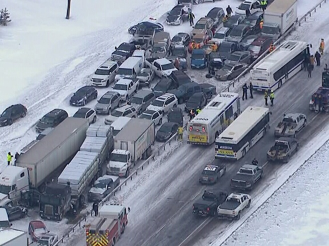 An aerial view of a multi-vehicle pileup is shown on Highway 400 near Innisfil, Ont., Thursday, Feb.27, 2014 in this television screen grab. THE CANADIAN PRESS/CTV