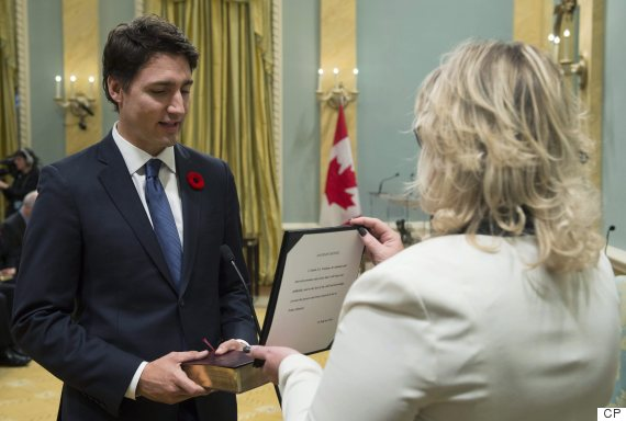 Justin Trudeau takes the oath of office as he is sworn in as prime minister at Rideau Hall in Ottawa on Wednesday, November 4, 2015. THE CANADIAN PRESS/Sean Kilpatrick